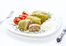 Stuffed cabbage leaves. With meat and rice and sour cream Stock Photo