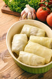 Stuffed cabbage leaves with minced meat and rice. Cookimg process. Stock Photo