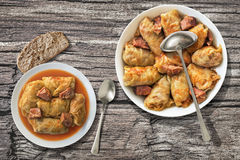 Stuffed Cabbage Meat Rolls Cooked And Served In Stainless Sauce-pot And Porcelain Plate Set On Old Garden Table Stock Photography