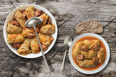 Stuffed Cabbage Meat Rolls Cooked In Stainless Sauce-pot And Served In Porcelain Plate Set On Old Garden Table Stock Images