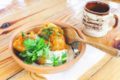 Stuffed cabbage on plate on wooden table Stock Photo