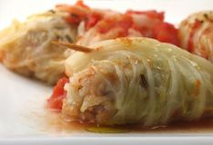 Stuffed cabbage roll. Toothpick holds a stuffed cabbage roll together on white plate Royalty Free Stock Photography