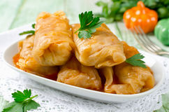 Stuffed cabbage rolls with rice and meat on a white plate Stock Photo