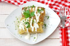 Stuffed cabbage rolls with sour cream close up Stock Photos