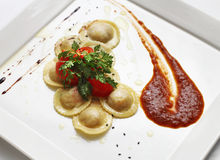 Stuffed cappelletti served with special sauce Royalty Free Stock Image