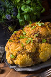 Stuffed cauliflower with mince and Hasselback potatoes Royalty Free Stock Image