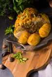 Stuffed cauliflower with mince and Hasselback potatoes Stock Photos