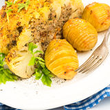 Stuffed cauliflower with mince and Hasselback potatoes Stock Images