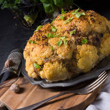 Stuffed cauliflower with mince and Hasselback potatoes Stock Photography