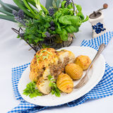 Stuffed cauliflower with mince and Hasselback potatoes Royalty Free Stock Photos