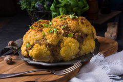Stuffed cauliflower with mince and Hasselback potatoes Stock Image