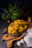 Stuffed cauliflower with mince and Hasselback potatoes Royalty Free Stock Photo