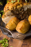 Stuffed cauliflower with mince and Hasselback potatoes Stock Photo