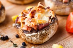 Stuffed champignons with ham and cheese Royalty Free Stock Images