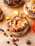 Stuffed champignons with ham and cheese Stock Photo