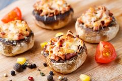 Stuffed champignons with ham and cheese Stock Image
