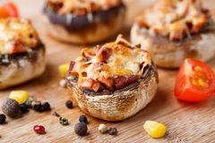 Stuffed champignons with ham and cheese Stock Images