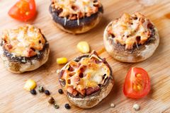 Stuffed champignons with ham and cheese Stock Photography