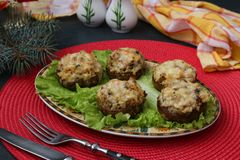 Stuffed champignons with mozzarella cheese, vegetables and bulgur royalty free stock photo