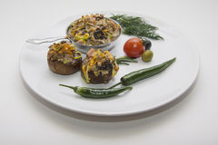 Stuffed champignons on plate Stock Images
