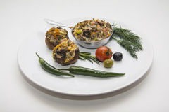 Stuffed champignons on plate Stock Photography