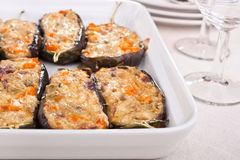 Stuffed with cheese aubergines in a dish Stock Photos