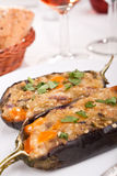 Stuffed with cheese aubergines in a dish Royalty Free Stock Photos