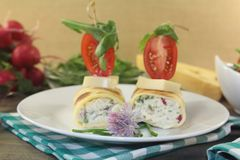 Stuffed cheese crepe rolls with tomatoes Stock Photos