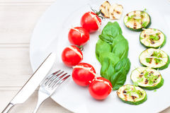 Stuffed cherry tomatoes with cheese and grilled zucchini Royalty Free Stock Image