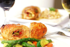 Stuffed Chicken. Two dinner plates with stuffed chicken and wine Stock Images