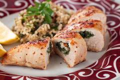 Stuffed chicken breast. Grilled chicken breast stuffed with spinach, served with bulgur wheat salad Royalty Free Stock Photos
