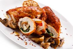 Stuffed chicken fillet with champignon stock photo