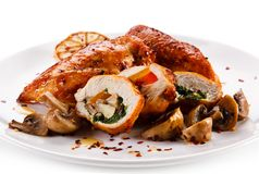 Stuffed chicken fillet with champignon royalty free stock photo