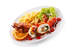 Stuffed chicken fillet with french fries and vegetable salad stock photos
