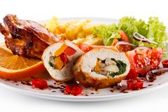 Stuffed chicken fillet with french fries and vegetable salad stock image