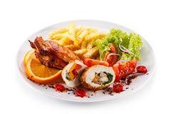 Stuffed chicken fillet with french fries and vegetable salad royalty free stock photos