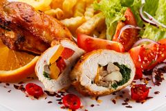 Stuffed chicken fillet with french fries and vegetable salad royalty free stock photo