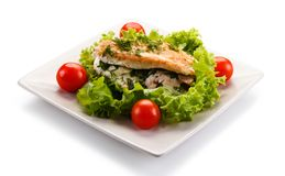 Stuffed chicken fillet and vegetables stock photo