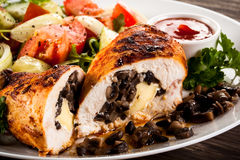 Stuffed chicken fillets and vegetables Royalty Free Stock Photos