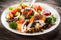 Stuffed chicken fillets and vegetables Stock Photos