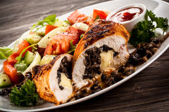 Stuffed chicken fillets and vegetables Royalty Free Stock Photography