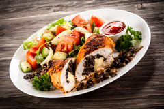Stuffed chicken fillets and vegetables Stock Photography