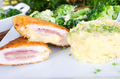 Stuffed chicken slices with broccoli and mashed potatoes Royalty Free Stock Images