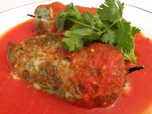 Stuffed Chili Peppers in Tomato Sauce Stock Photo