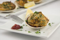 Stuffed clams appetizer. With fork Stock Images