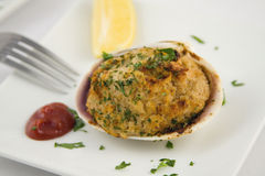 Stuffed clams appetizer. With fork Stock Photos