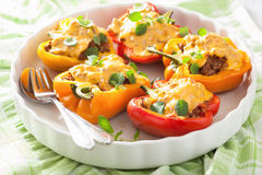 Stuffed colorful peppers with meat cheese vegetables Royalty Free Stock Images