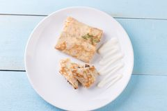 Stuffed crepes topped with sour cream Stock Photos