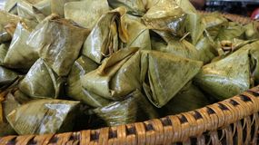 Stuffed Dough Pyramid wrapped in banana leaves Stock Images