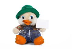 Stuffed duck holding white card Royalty Free Stock Photography